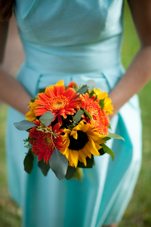 Aqua Bridesmaid with Orange Bouquet