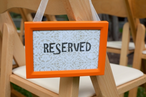 Reserved Chair Sign at Casual Wedding