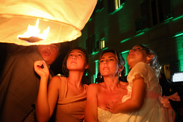 Couple Lighting a Chinese Wedding Lantern