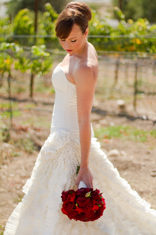white wedding gown red bouquet Napa Valley Red and White Wedding by Cathy Stancil Photography