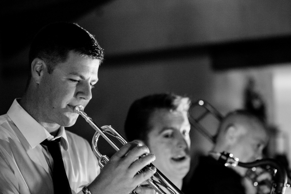 groom playing trumpet at wedding La Massaria At Bella Vista Wedding by Ashley Gerrity Photography