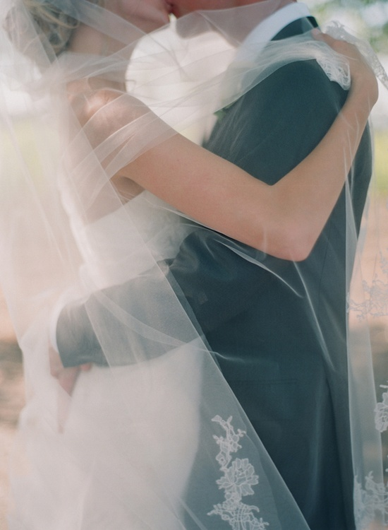 Couple Under Wedding Veil