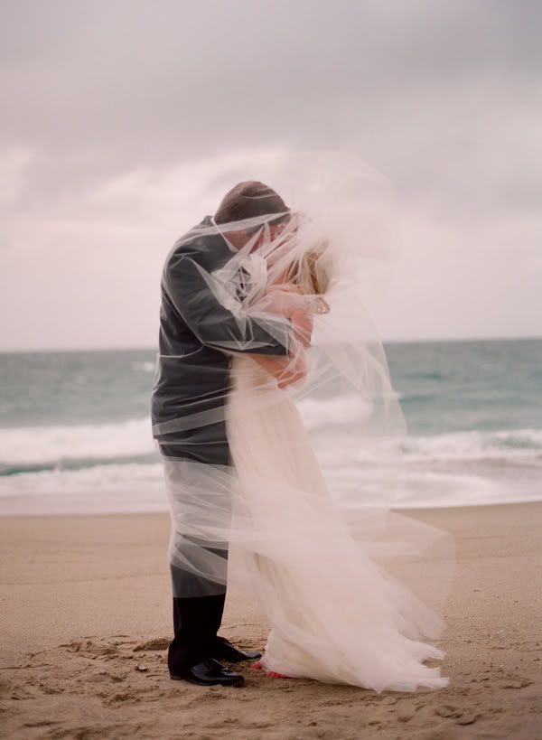 Kiss Under Veil at Beach